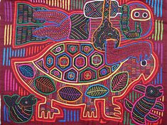 Molas are reversed appliques, constructed of many colorful layers of cotton fabrics, made by the indigenous women of the San Blas Islands, near the Panama Canal.  I love their beautiful work.....vwr