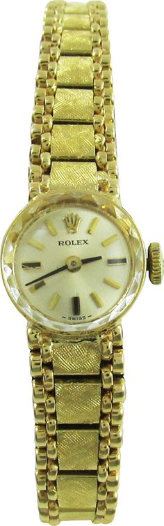E.D. Marshall Jewelers pre owned Ladies Vintage Rolex. Reference Number 94730. Manual movement. Functions include; Hours/Minutes. Case material is 14 KYG, with a 23mm diameter. Fixed Gold bezel, with silver dial.. Gold stick markers. The Bracelet is 14 KY Integral Fancy. This watch is Swiss made.