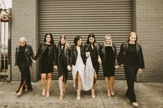 WEDDING ATTIRE | All black everything bridesmaid dresses & leather jackets, bride in casual leather jacket