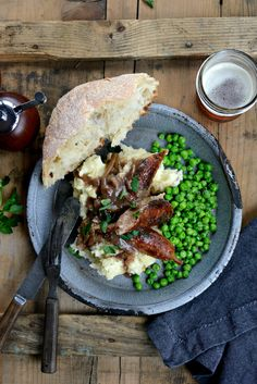 Irish bangers and mash with caramelized onion gravy is soul warming comfort food at it's best. Serve with crusty bread and peas.