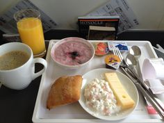 Breakfast in business class onboard the Swiss London City to Basel service, Cherry and granola compote, cheese and a warm roll with coffee and orange juice International Airlines, Air Photo, Commercial Aircraft, Business Class, Fried Fish, Grubs, Flight Attendant, London City, Orange Juice