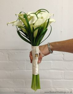 Wedding Flowers Liverpool, Merseyside, Bridal Florist, Booker Flowers and Gifts, Booker Weddings Calla Lily and Lily Grass Hand Tied Bridal Bouquet Side View Lily Bouquet Wedding, Calla Lily Bouquet, Calla Lillies, White Wedding Flowers, Bride Bouquets, White Flowers, Bridesmaid Bouquets, Lilies, Wedding Arrangements