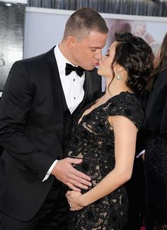 How sweet! Soon-to-be parents Channing Tatum and Jenna Dewan share a smooch, never removing their hands from little baby Tatum.