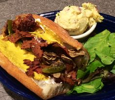 BLUE PLATE SPECIAL 11-12-14: PHILLY CHEESESTEAK Our house-made Seitan on an Iggy's baguette dressed with Garlic Mayo, Grilled Onion, Green Peppers and Button Mushrooms. Topped off with house-made #vegan Cheese Whiz (nut based). Served with dressed Greens and side of our Green Cabbage Slaw, Potato Salad, or crunchy house-made Potato Chips. www.veggiegalaxy.com