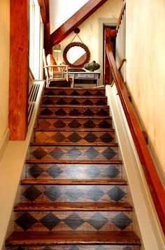Staining & painting stairs creates a welcoming entrance to a home's second floor