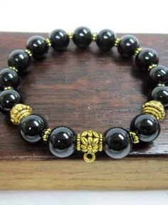 Shop genuine healing black tourmaline bracelets, including the popular stretch beaded stone bracelets. Raw Gemstone Jewelry, Gemstone Bracelets, Crystal Jewelry, Beaded Jewelry, Raw Gemstones, Natural Gemstones, Buy Crystals, Black Tourmaline, Bracelet Making