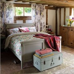 Floral bed linen and miss match furniture create an ultimate in country bedrooms