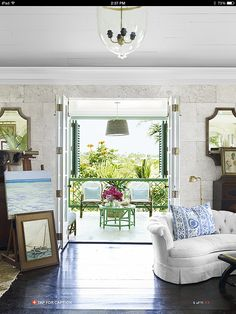 French Doors and porch shutters that can close. Amanda Lindroth keeps the bifold French doors of the great room open to the luxuriant greenery and a view of the sea. Bahama home. Beautiful Interior Design, Beautiful Interiors, Beautiful Homes, House Beautiful, Beautiful Gorgeous, Bifold French Doors, Bahamas House, Green Painted Furniture, Usain Bolt