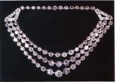 The Festoon Necklace. Eager to make use of some 239 diamond collets casually inherited, George VI commissioned a necklace using 105 of the gems. In 1947, a three-strand necklace was created, which were hung between two diamond triangles at either ends. The weight of the necklace is a whopping 170 carats.