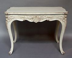 """Center table, Sweden circa 1880, with shaped top and rococo legs. Wonderful carvings on the apron and knees.   H:30½"""", W:43"""", D:27½"""".  Ref. #82-05"""