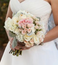 Hand-tied romantic garden bouquet with ivory hydrangea, soft pink garden roses, ivory and champagne roses with dusty miller accents