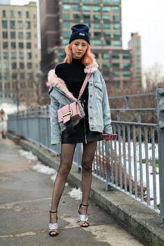 Korean model Irene Kim at NYFW carrying Prada Plex Ribbon bag