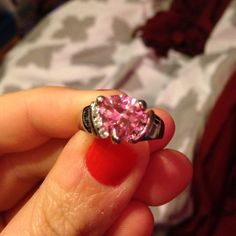 Pink stone ring Pink center stone and 3 mini diamond like stones on the sides. Not sure on the size i'm thinking a 6 or 7. It's not stamped at all. It's very pretty and sparkles a ton! Jewelry Rings