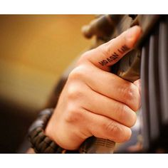 Love this trigger finger tattoo!  I'd totally get it, molon labe!