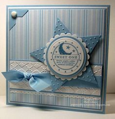 handcrafted Baby Boy greeting card ... baby blue, white and dove gray ... luv the layout ... large medallion  .... star die cut base, scallop edged circle, gray circle and top white circle with baby sentiment ... delightful card!!!