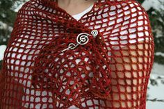 A free pattern for an easy trellis lace crocheted stole. The East Trellis Lace Stole is a fun fashion accessory you can dress up or down. Beaded edges add a hint of sparkle to a simple stitch pattern.