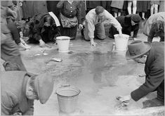 Jews in Vienna forced to scrub street pavements, directly after Austria's annexation to the German Reich, 1938.