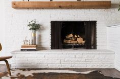 I love how this fireplace gives off an asymmetrical design. Brick Fireplace Makeover, Fireplace Shelves, Fireplace Remodel, Fireplace Mantle, Fireplace Design, Library Fireplace, Fireplace Ideas, Classic Living Room, Home Living Room
