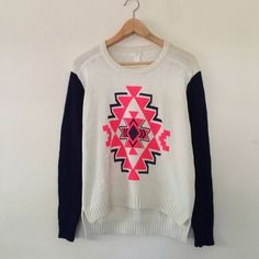 Forever 21 Knit Sweater size medium never been used Aztec print sweater with blue sleeves. This has still the plastic tag almost attached. Was just closet stored! Size medium and is true to size will fit a small oversized. So so so cute  Forever 21 Sweaters