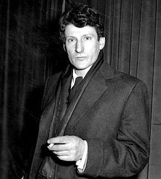 German-born British painter Lucian Freud poses for the camera in 1958.