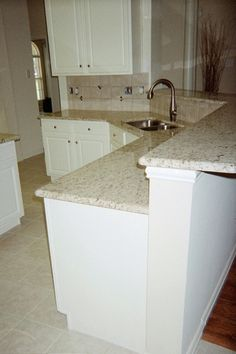 Giallo Ornamental Granite Countertops On White Cabinets