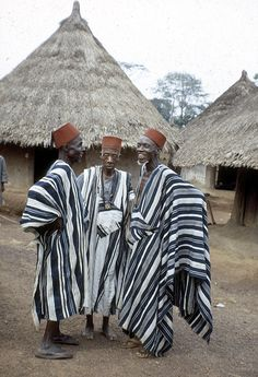 Dan men wearing hat called tarboosh, Man region, Ivory Coast.The photograph depicts three men wearing black and white robes of locally woven cloth. Their red hats, Tarboosh, are similar to those worn by other Moslems further north. This photograph was taken when Eliot Elisofon was on assignment for Westinghouse Film and traveled to Africa from October 26, 1970 to end of March 1971. eepa_02708.jpg (840×1230)