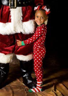 Santa picture with child hugging Santa's leg