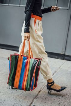 What do you think of this striped Balenciaga bag? We know we adore it.