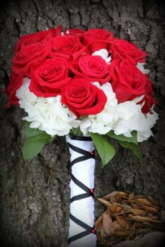 This Bridal bouquet is created with white hydrangea, red roses and has unique hand tied detailing.  Submitted by : CREATIVE HAND'S FLOWERS & GIFTS in Waller, Texas