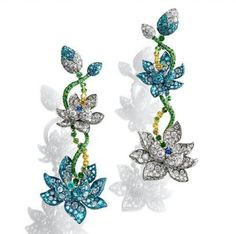 @annahu_hautejoaillerie.  My Celestial Lotus Earrings is inspired by the natural lotus motif. Each earring consists of a pair of lotuses in graduating size, trembling from their green garnet and yellow diamond tendrils, each differentiated slightly in color from the other via either the presence or absence of those vivid blue Paraiba tourmalines and sapphires.  The piece symbolizes East and West' beauty and spirituality. #annahudesign