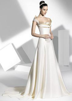 Vestidos de novia de línea sirena con amplio escotes asimétricos.