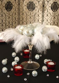 Something diff with a martini glass and feathers and mirror balls