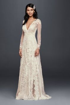 Romantic lace gets a fresh take on this sheath wedding dress with a captivating linear motif featuring four different lace appliques. Long illusion sleeves and a deep V-neckline make it luxurious from shoulder to hem