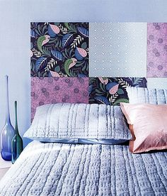 Use large sheets of scrapbook paper as a temporary headboard.  I like the color scheme