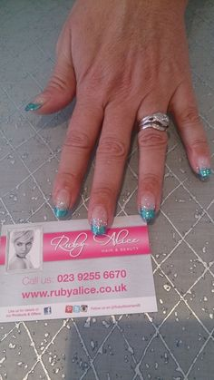 French turquoise glitter tips with silver fading glitter