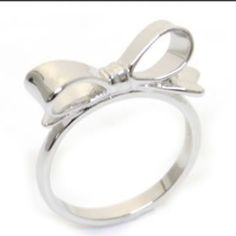 ♠️Kate Spade♠️Silver Bow Ring♠️ New with tags and dust bag♠️I have this in gold, rose gold & silver. All size 7. Make an offer! kate spade Jewelry Rings