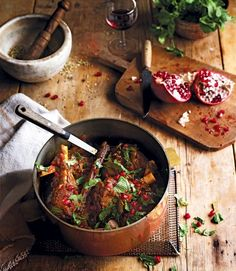 Lamb shanks lend themselves to being cooked slowly so that when it comes to eating they are melt-in-the-mouth tender. This recipe combines the meat with Indian spices and fresh herbs and pomegranate.