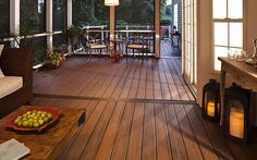 The rich umber of #Trex Transcend decking in Spiced Rum gives this enclosed porch a warm and cozy feeling. It's easy to imagine curling up with a good book or entertaining guests.