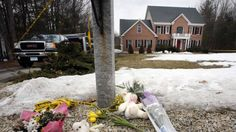 A memorial appears on display in front of a home, Monday, March 30, 2015, in Bedford, N.H., where New Hampshire Assistant Attorney General Jay McCormack said police received a 911 call Saturday regarding a deceased woman at the home. He says when officers arrived, they found two more people dead. (AP Photo/Jim Cole)