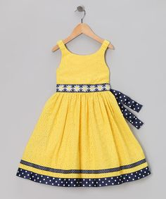 As bright as a daisy, this dress features eyelet with a contrasting tie. Stretchy straps and a zipper mean this piece is ready to join the party in playful yet pretty fashion.66% polyester / 34% cottonLining, trim and embroidery: 100% polyesterMachine wash; tumble dryImported