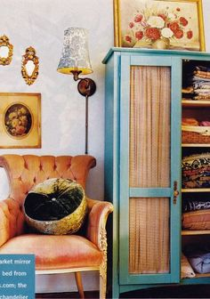 Pretty Cabinet--use curtains instead of glass--- softens and is beautiful.