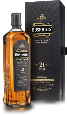 Bushmills 21 Year Old Single Malt Irish Whiskey. Aged for 19 years in ex-American and ex-Spanish sherry casks, this rare Irish is then married together for an additional two years in madeira-infused casks. Jameson Irish Whiskey, Whiskey Sour, Irish Whiskey Brands, Single Malt Irish Whiskey, Cigars And Whiskey, Scotch Whiskey, Whiskey Bottle, Whiskey Gifts, Whiskey Decanter