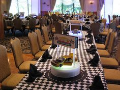 Custom centerpieces for an exotic car themed Bar Mitzvah included a rotating LED light base, custom logo and a collection of die cast sports cars by The Prop Factory, via Flickr