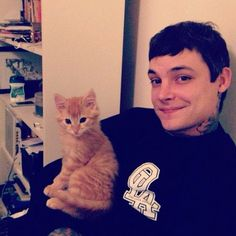 Ahren stringer with a kitty. Seriously one of the most adorable things on the planet. The amity affliction