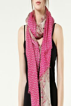 The Mixed Bird Print Scarf features two contrasting prints in complementary colours and a frayed, raw edge.