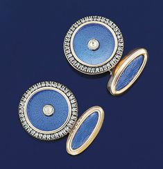 A pair of enamel and diamond cufflinks  Each blue guilloché enamel circular panel with rose-cut diamond centre and border, to opposed blue guilloché enamel marquise panels with chain link connections