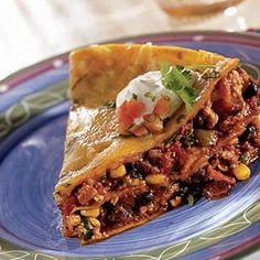Recipe for Enchilada Pie - Delight in this Mexican favorite, filled with lean ground turkey, bell pepper, tomatoes, chilies, black olives and corn layered between corn tortillas and shredded cheese.