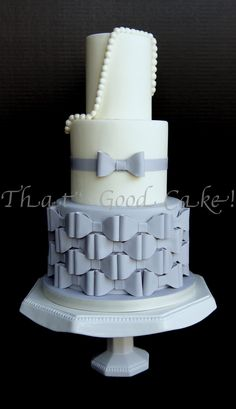 'The Jessica Harris' Bow Cake - I used Jessica Harris' bow template and tweeked it to make this inspired cake for a competition in Austin.  It placed 3rd in the Adult Professional division for 'wedding' styled cakes.  This cake gives both the bride and groom a little of both- sweet, structured and modern.  This cake design would work well with any color since the bow pattern becomes a structured geometric feel.  The pearls can be placed at the bottom of top the tiers for a new look.  Have…