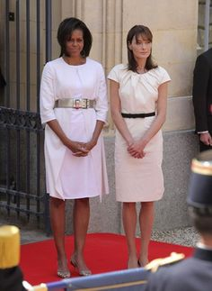 Belted White Sheaths It's almost as if first ladies Michelle Obama and Carla Bruni Sarkozy called each other before the international ceremony commemorating the 65th anniversary of D-Day, and planned their outfits. We love their cinched white dresses! Michelle belted her Michael Kors dress with Givenchy and sported a Narciso Rodriguez coat over it, while Carla chose a Dior satin sheath. Like the look but can't splurge on designer wear? Try cinching this Splendid Linen Pinch-Pleat Dress (at…