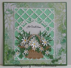 delightful handmade get well card ... green & white ... basket ful of punched white daisies with yellow centers ... French trellace die cut panel ... lovely watercolor look print paper base .. luv it!!!